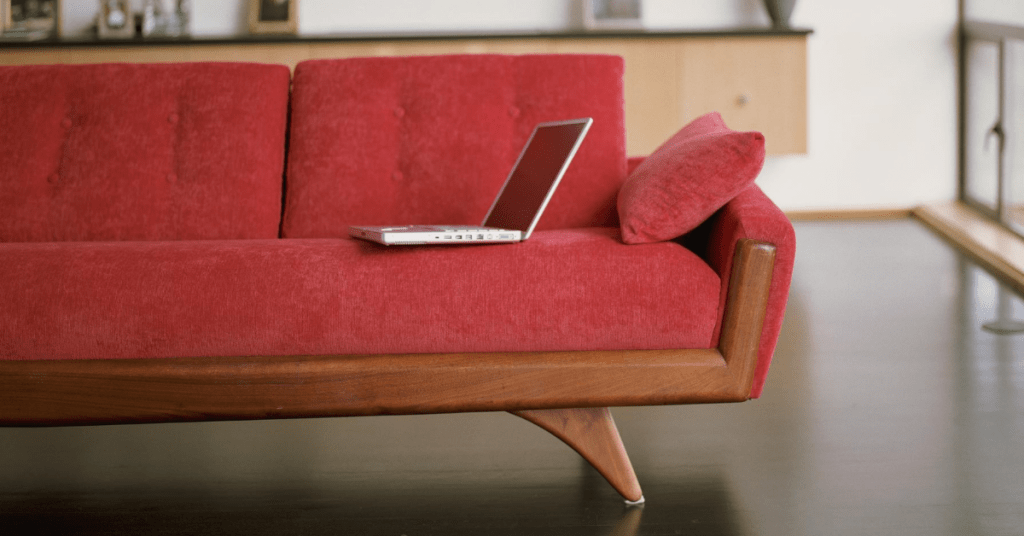 laptop on a red couch