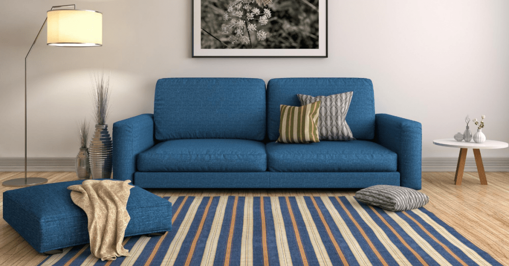 two seater blue couch with matching stripes carpet