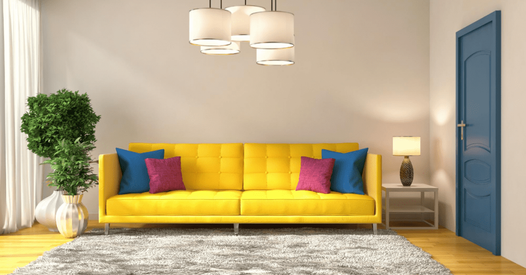 bright yellow couch with blue and maroon throw pillows