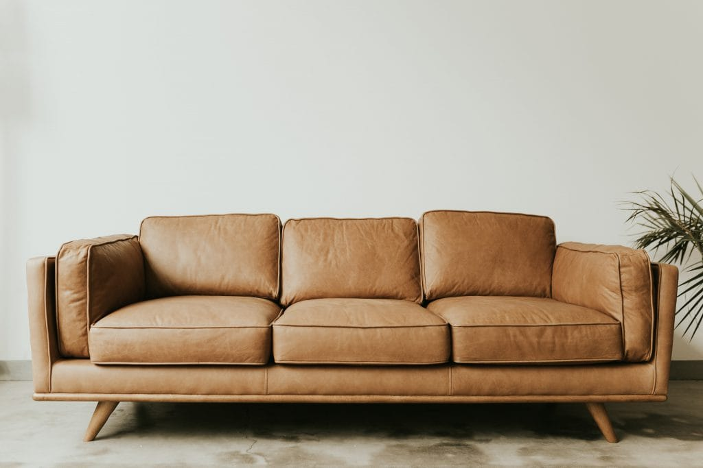 three seater leather brown couch