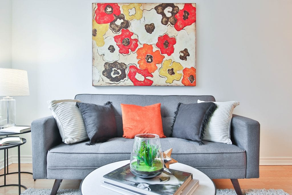 gray theme living room with orange and red accent