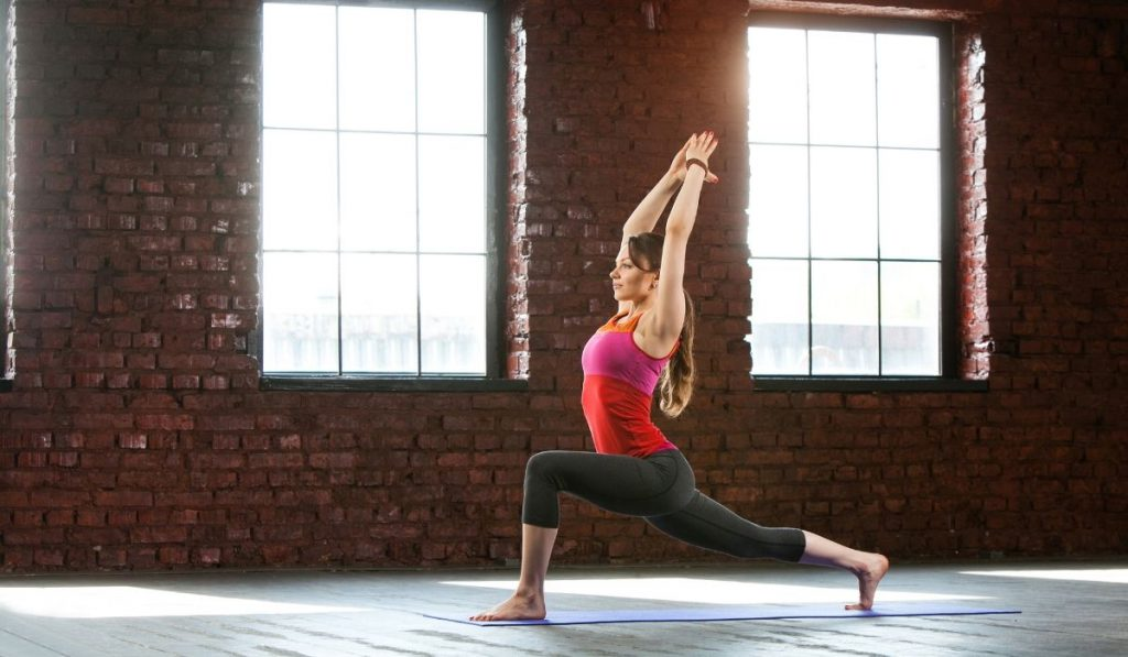 woman doing yoga in an empty spacious space